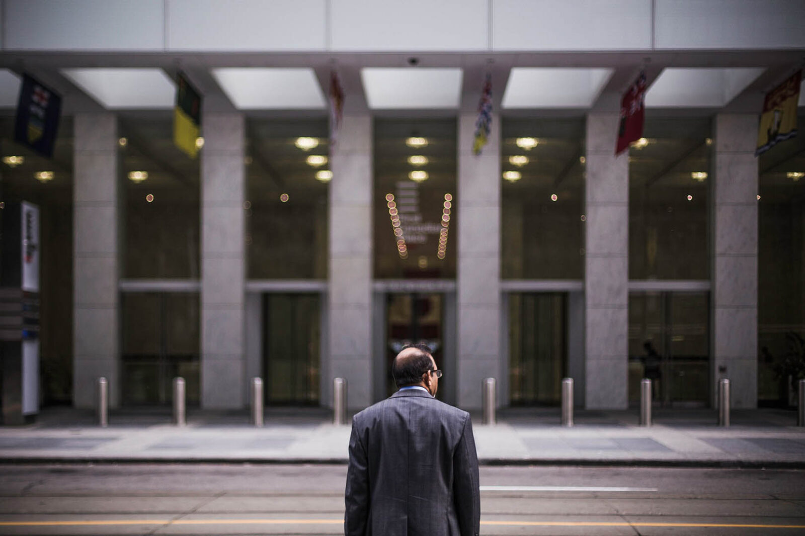 Office worker in front of building