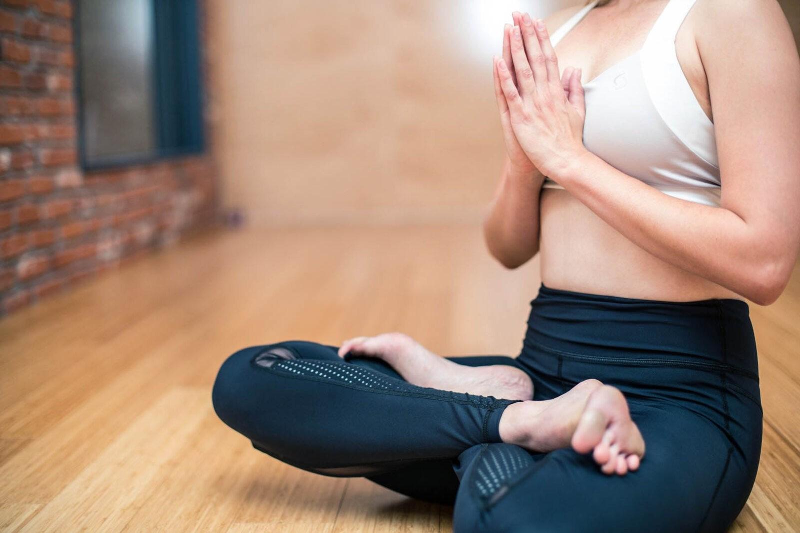 Woman doing yoga, sitting legs crossed